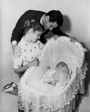 Eddie Fisher, Debbie Reynolds in the first picture with their baby daughter, Carrie