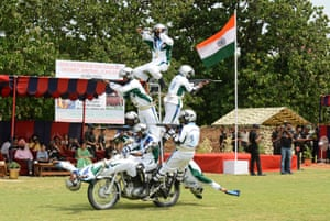 Amritsar, India Soldiers from the Daredevils motorcycle team perform stunts during celebrations to mark the country's independence day, marking the end of British colonial rule