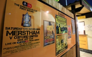 A sign advertising the FA Cup first-round tie between Merstham and Oxford United at Moatside.