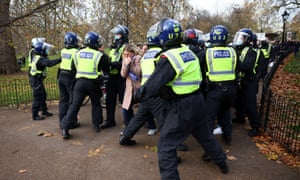 Police officers block a path during an anti-lockdown demonstration amid the coronavirus disease outbreak in London, Britain November 28, 2020.