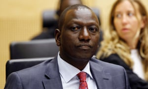 William Ruto sits in the courtroom of the international criminal court in the Hague.