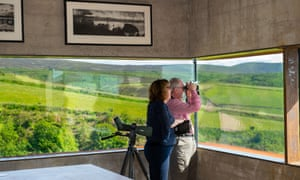 'Every morning we spot something out the window, drop our spoons and rush to get the binoculars': Peter and Carole Lillywhite at home.
