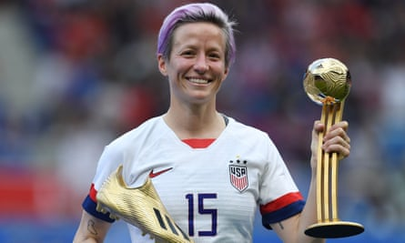 Megan Rapinoe with the Golden Boot and Golden Ball trophies after the US beat the Netherlands in the World Cup final.