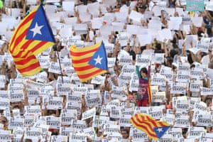 Demonstrators hold up signs to demand the release of the imprisoned Catalan leaders Jordi Sánchez and Jordi Cuixart