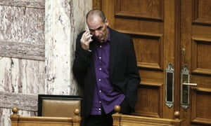 Greek Finance Minister Yanis Varoufakis, speaks on his phone during the vote for the president of Greece's parliament in Athens.