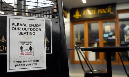 Social distancing signage is seen at the Thai Rock restaurant in Sydney's west. On Sunday it was revealed the coronavirus cluster linked to the restaurant had risen to 67 cases.