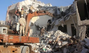 Syrian civil Defence members search for survivors amid rubble following reported air strikes on the city of Idlib.