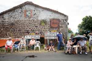 Locals wait for the riders to pass by near Col de Peyra Taillade
