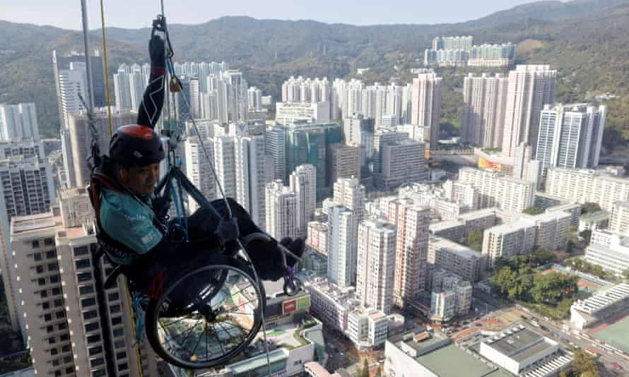 Lai Chi-wai on his attempt to climb the 320-metre tall Nina Tower.