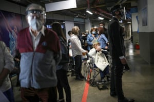 People wait in line to receive Sinovac's coronavirus vaccine during the mass vaccination program for elderly people at Movistar Arena in Bogota, Colombia on 9 March, 2021.