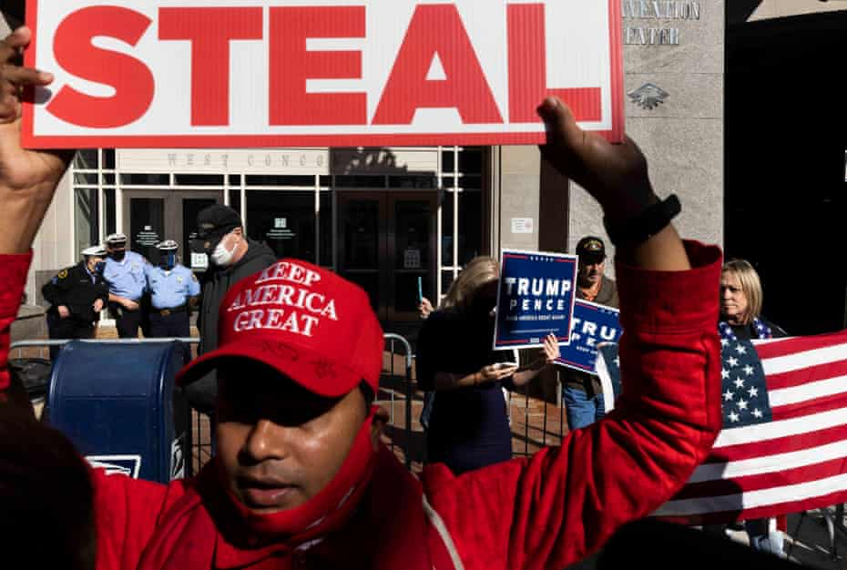 Supporters of President Trump, who are questioning, without evidence, the legitimacy of the state's vote counting, gather outside of the Pennsylvania Convention Center in Philadelphia, Pennsylvania, USA, 06 November 2020.