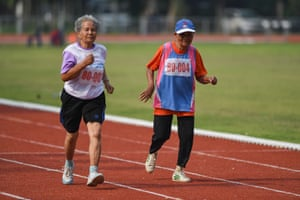 Women in the 80-85 age category running the 400-metre race