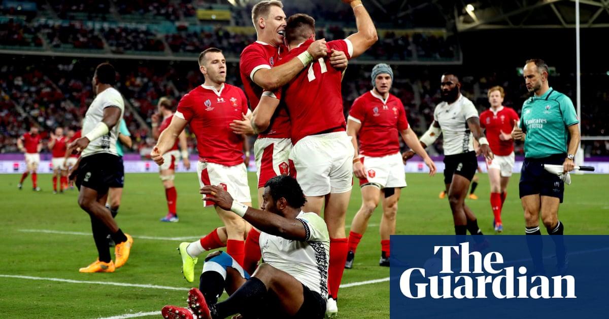 Wales survive major Fiji scare as Josh Adams hat-trick seals top spot
