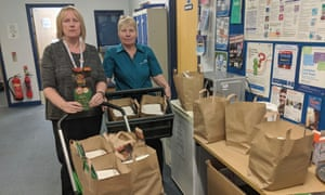 Yvette Black (left) and Dawn Sturgeon-Brown in Sheppey community hospital with some of the free meals Taste of India has provided for NHS staff