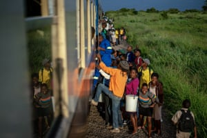 Commuters clamber aboard a train heading for the city in Bulawayo, Zimbabwe.