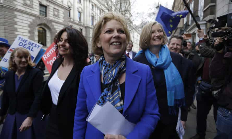 British politicians Anna Soubry, center, Heidi Allen, second left, and Sarah Wollaston, right