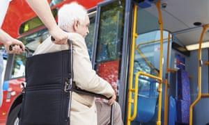 Senior Couple Boarding Bus Using Wheelchair Access Ramp