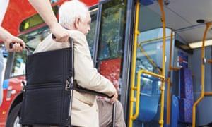 A wheelchair user boards a bus