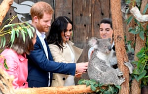 Britain's Prince Harry and his wife Meghan meet a koala named Ruby and its koala joey named Meghan after the Duchess of Sussex during a visit to Taronga Zoo in Sydney on October 16, 2018