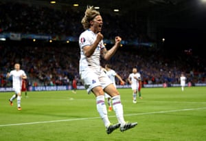 Birkir Bjarnason celebrates after scoring for Iceland against Portugal at Euro 2016.