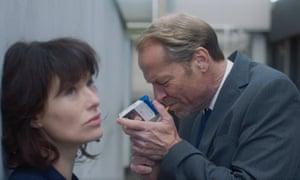 Lena Headey and Iain Glen star as immigration officers in The Flood.