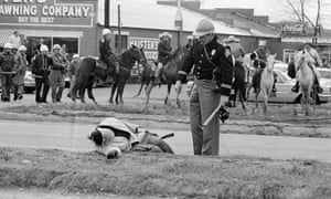 A freedom marcher lies unconscious in Selma, Alabama, after being attacked by the police.