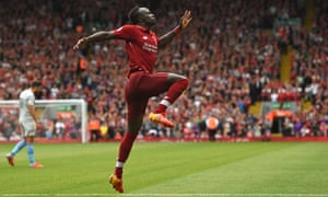 Sadio Mané celebrates after scoring his second and Liverpool's third goal.