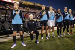 Megan Rapinoe kneels during the playing of the national anthem before the soccer match against Thailand last month.
