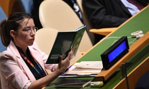 A delegate from Venezuela looks at a book during US President Donald Trump's address at the 74th Session of the United Nations General Assembly at UN Headquarters in New York