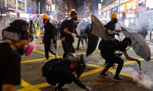 Protesters take cover from teargas canisters