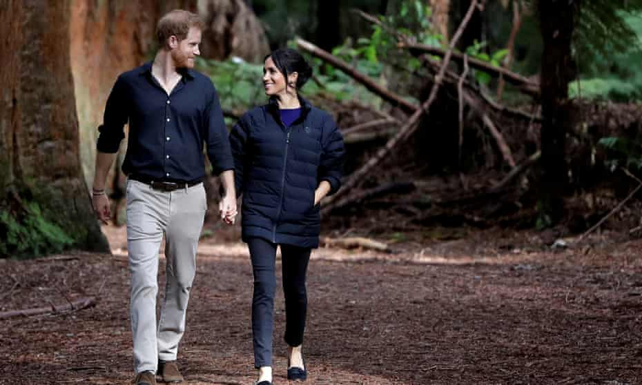 Britain's Prince Harry and Meghan, Duchess of Sussex walk through a Redwoods forest in Rotorua, New Zealand,