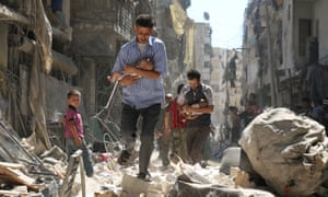 Syrian men cradle babies as they navigate the rubble of destroyed buildings after an air strike on Aleppo's Salihin district in September 2016