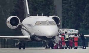 Alexei Navalny being lifted out of an air ambulance in Berlin.