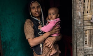 Rohingya woman with her baby