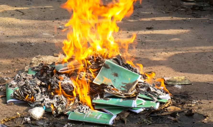 Copies of the 2008 constitution are set on fire by protesters in Yangon's Tamwe township