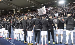 The LASK players celebrate with their fans after eliminating AZ Alkmaar in the round of 32 of the Europa League.