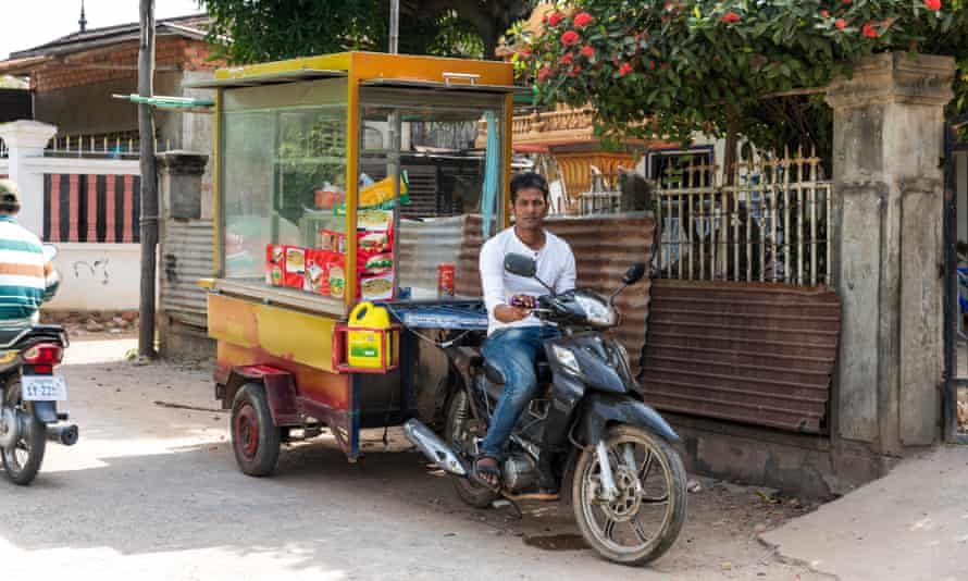 Rashid with his cart for selling roti