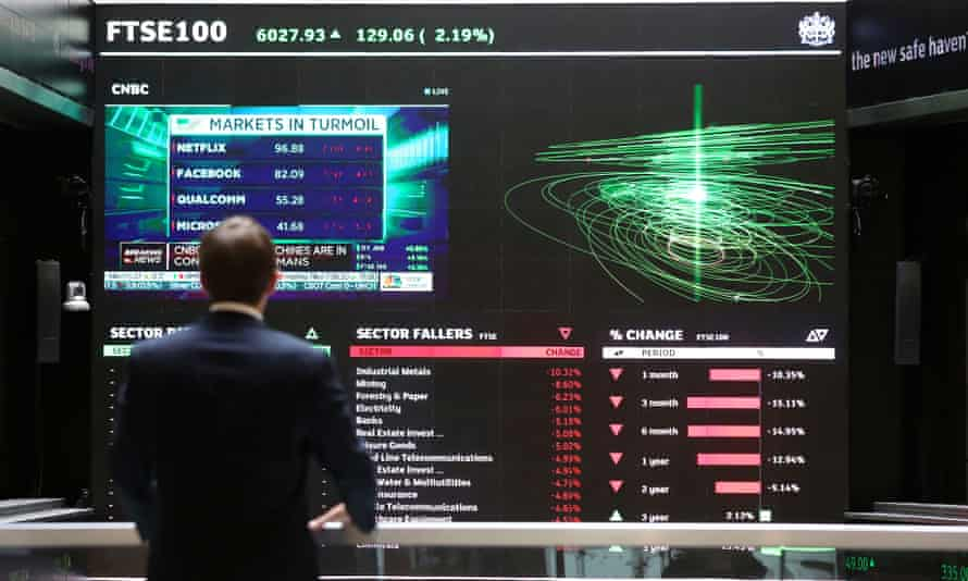 A stock ticker screen at the London Stock Exchange in the City of London