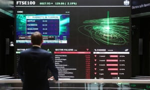 A city worker looks at a stock ticker screen at the London Stock Exchange