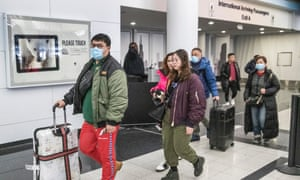Passengers arrive at O'Hare International airport after exiting customs and screening areas in Chicago, Illinois, on 24 January 2020.