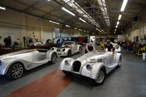 Cars are pushed from one production point to the next at Morgan Motor Company in Malvern