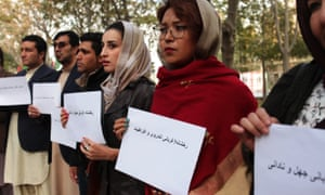 Demonstrators protest against violence against women in Kabul's Zarnegar Park in November, after a woman was stoned to death for trying to elope.
