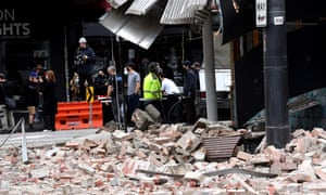 People gather near a damaged building in Chapel Street after the 5.8 magnitude quake on Wednesday.