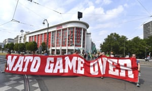 Protesters march with a banner which reads 'Nato Game Over' during a demonstration in Brussels on Saturday.