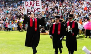 Stanford student Paul Harrison carries a sign in a show of solidarity for a Stanford rape victim during graduation ceremonies in Palo Alto, California on 12 June 2016.
