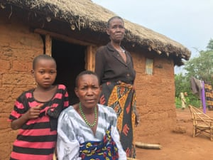 Rahel Charles Rosana, centre, with her mother and daughter at their home outside the village of Misasi.