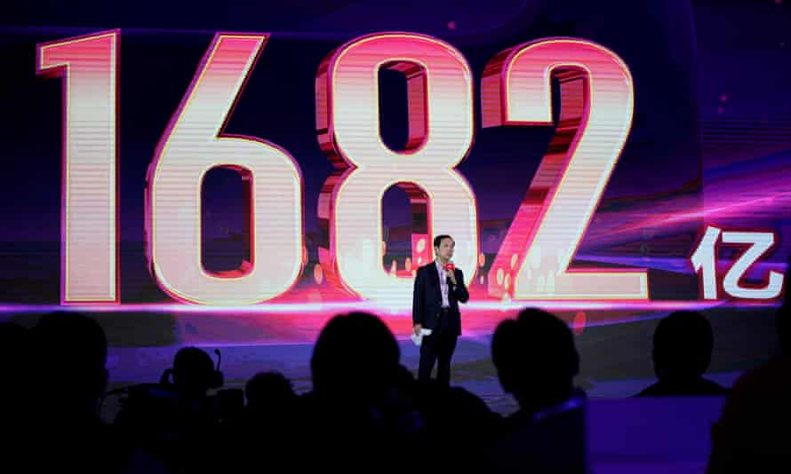 Daniel Zhang, chief executive officer of Alibaba, at the group's singles day festival in Shanghai with the yuan spending total of 168.2bn shown on the screen.