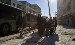 Syrians evacuate Aleppo in December 2016.