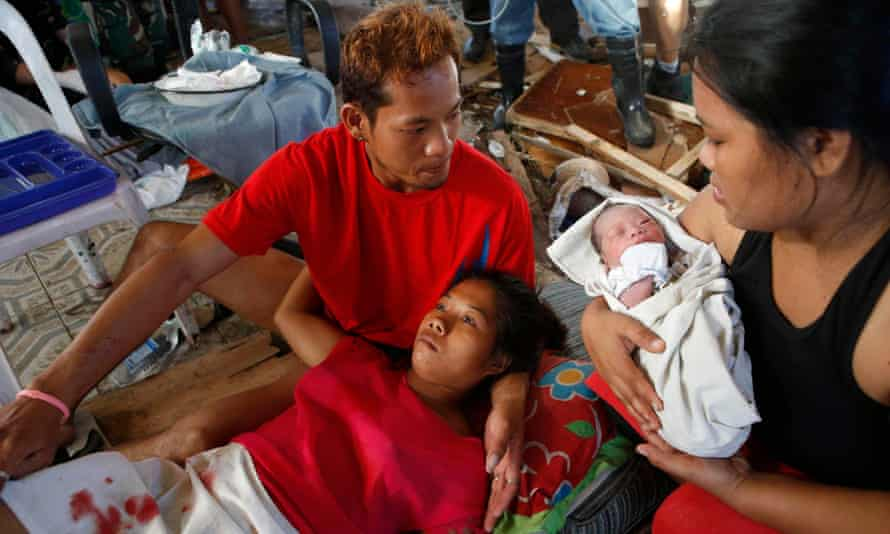 A mother recuperates at a makeshift clinic after typhoon Haiyan hit the Philippines. Ketamine is particularly useful for emergency caesarean sections.