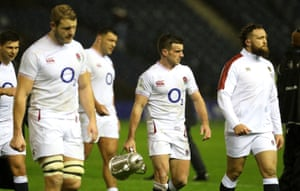 George Ford carries the Calcutta Cup.